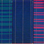Cropped image of multicoloured woven fabric in blue and purple hues