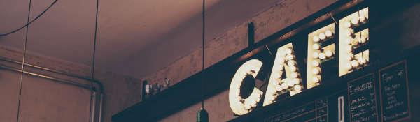Cropped image of illuminated 'Cafe' sign - for Café CAT survey