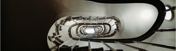 black and white image of stairway spiral from above